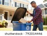 man filling recycling bin on...   Shutterstock . vector #792014446
