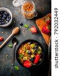 healthy breakfast with muesli... | Shutterstock . vector #792032449