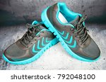 pair of blue  sports shoes with ... | Shutterstock . vector #792048100