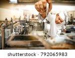 cook chef in kitchen interior....   Shutterstock . vector #792065983