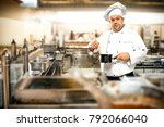 cook chef in kitchen interior.... | Shutterstock . vector #792066040