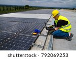 fitting photovoltaic panels on... | Shutterstock . vector #792069253