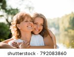 mature mother hugging with her... | Shutterstock . vector #792083860