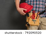 closeup of hardhat held by... | Shutterstock . vector #792090520