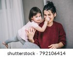beautiful caucasian mother and... | Shutterstock . vector #792106414