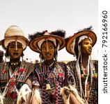 Small photo of Men dancing Yaake dance and sing at Guerewol festival - 23 september 2017 InGall village, Agadez, Niger