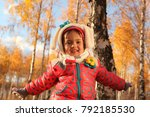 the girl in the autumn forest | Shutterstock . vector #792185530
