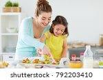 family  cooking and people... | Shutterstock . vector #792203410