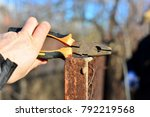 welder makes a fence in the... | Shutterstock . vector #792219568