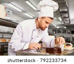 man confectioner with a cake in ... | Shutterstock . vector #792233734