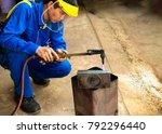 men are welders blue uniforms... | Shutterstock . vector #792296440