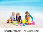 child playing on tropical beach.... | Shutterstock . vector #792321820