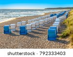 beach with beach chairs in a... | Shutterstock . vector #792333403