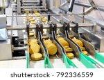 conveyor belt with biscuits in... | Shutterstock . vector #792336559