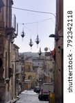 Small photo of Noto, Sicilia / Italia - January 5 2018: a small alley with hanging lamps