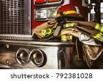 firefighter gear and helmet | Shutterstock . vector #792381028