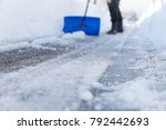removing snow and ice from the... | Shutterstock . vector #792442693