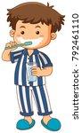 Boy In Pajamas Brushing Teeth...