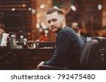 barbershop. man with a beard... | Shutterstock . vector #792475480