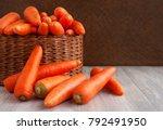 carrots in a wicker box. a lot... | Shutterstock . vector #792491950