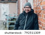 casual man wearing a beanie and ... | Shutterstock . vector #792511309