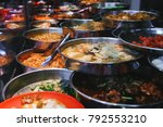 metal plates with asian food.   Shutterstock . vector #792553210