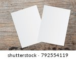 Stock photo white paper and space for text on old wooden background 792554119