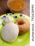 Small photo of Meduwada & Idli on a green plate with chutney & sambhar