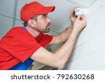 worker installing or adjusting... | Shutterstock . vector #792630268