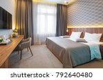 Stock photo hotel bedroom interior in the morning 792640480