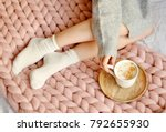 young woman sitting on the bed... | Shutterstock . vector #792655930