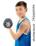 Young teenage boy exercising with dumbbells isolated against a white background - stock photo