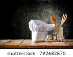 cook hat and wooden table of... | Shutterstock . vector #792682870