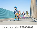 boy playing roller skates with... | Shutterstock . vector #792684469