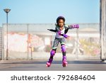 african girl rollerblading fast ... | Shutterstock . vector #792684604