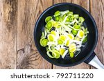 chopped leeks in frying pan.... | Shutterstock . vector #792711220