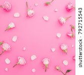 Stock photo floral frame with roses flowers and petals on pink background flat lay top view valentines day 792715543