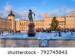 Small photo of Gatchina, Russia - January 7, 2018: New Year Fair on the parade ground in front of the Gatchina Palace. In the foreground is a monument to Emperor Paul 1.