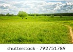landscape of a green meadow and ... | Shutterstock . vector #792751789