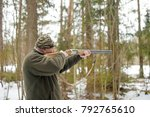 hunter in winter forest with... | Shutterstock . vector #792765610