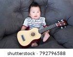 lovely baby sitting on the soft ...   Shutterstock . vector #792796588