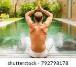 man sitting in lotus yoga... | Shutterstock . vector #792798178