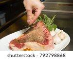 uncooked t bone being seasoned... | Shutterstock . vector #792798868