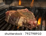 t bone being flame grilled to... | Shutterstock . vector #792798910