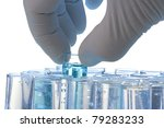 Hand Holding A Test Tube On A...