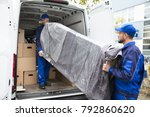 two young delivery men in... | Shutterstock . vector #792860620