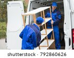 two young delivery men in... | Shutterstock . vector #792860626