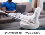 man with broken leg sitting on... | Shutterstock . vector #792865393