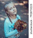 child walking in the park. | Shutterstock . vector #792873223