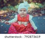 child walking in the park. | Shutterstock . vector #792873619